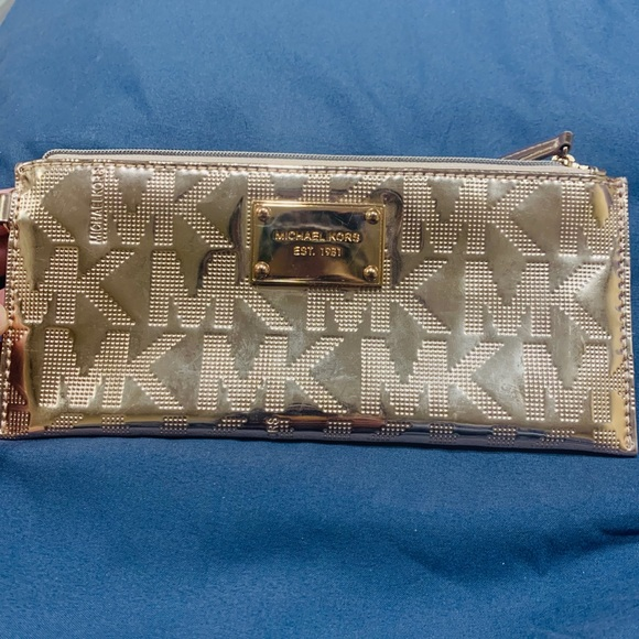 Micheal Kors rose gold clutch with strap